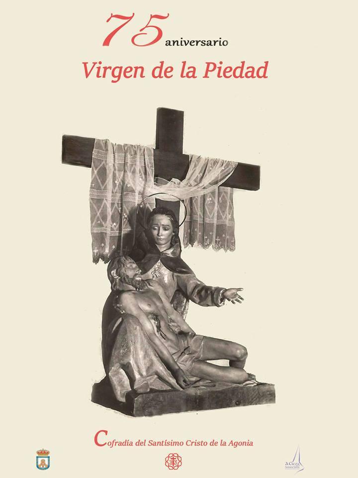 Montaje del Cartel de la exposición de la Piedad en Galería eFe Serrano de Cieza.